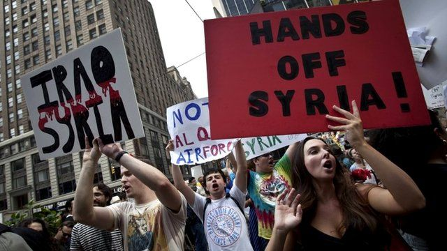 People protest against proposed US military action against Syria in Times Square, New York