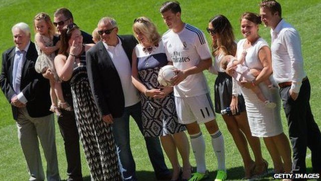 Gareth Bale poses with his family on the Madrid pitch