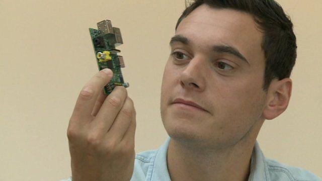 Joe Tidy looking at a computer chip board