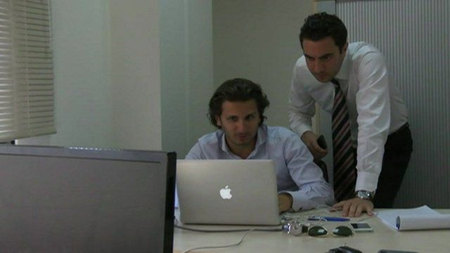Two workers in an office.