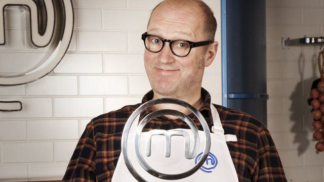 Ade Edmonson with the Celebrity Masterchef trophy