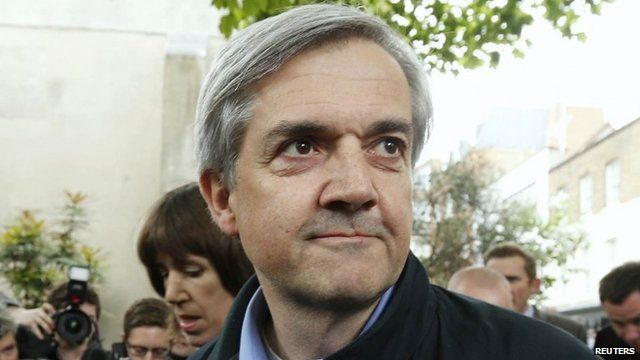 Former British cabinet minister Chris Huhne arrives back at his home after being released from prison