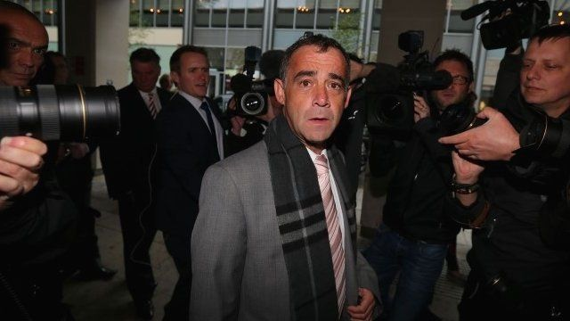 Michael Le Vell outside court surrounded by press