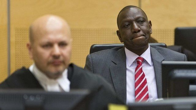 """Kenya""""s Deputy President William Ruto (R) reacts as he sits in the courtroom before his trial at the International Criminal Court (ICC) in The Hague September 10, 2013."""
