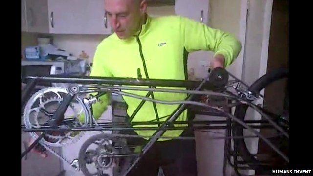 Graeme Obree showing how the cycle mechanism works on his bike Beastie
