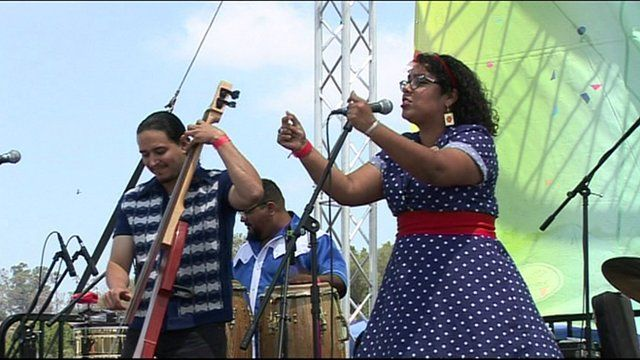 La Santa Cecilia perform on stage