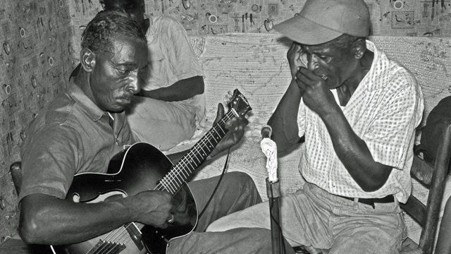 Blues musicians playing a guitar and harmonica