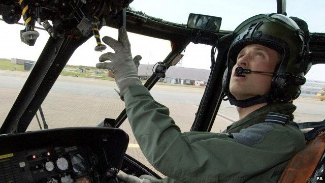 Prince William in a Sea King helicopter