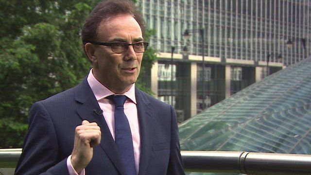 Tony Lomas, lead administrator at PWC, standing outside a glass building