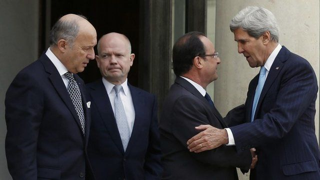U.S. Secretary of State Kerry says goodbye to French President Hollande after their meeting regarding Syria at the Elysee presidential palace in Paris