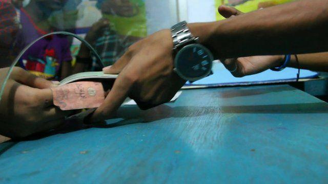 Money handed to bank teller