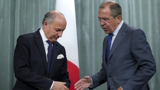 French Foreign Minister Laurent Fabius, left, and his Russian counterpart Sergei Lavrov