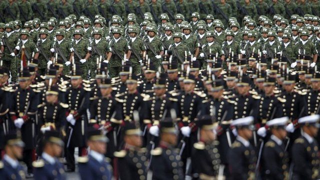 Soldiers participate in a military parade celebrating Independence Day at the Zocalo square in downtown Mexico City