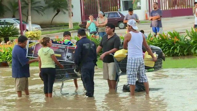 Looters with a shopping trolley full of supplies and exercise equipment
