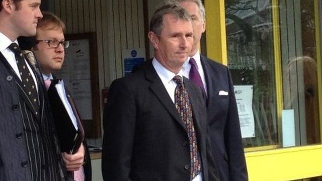 Nigel Evans (centre) wearing a dark suit