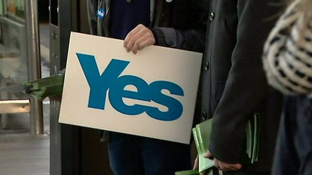 Person holding a Yes sign