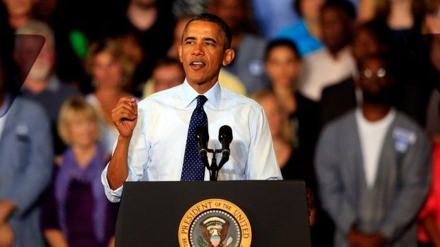 US President Barack Obama speaks to workers as he visits the Ford Kansas City Stamping Plant, Liberty, Missouri, on 20 September 2013
