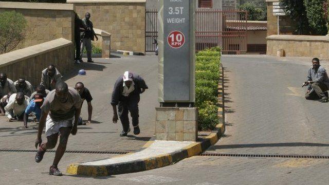 Gun battle outside the Westgate Mall, an upscale shopping mall in Nairobi, Kenya Saturday Sept. 21 2013