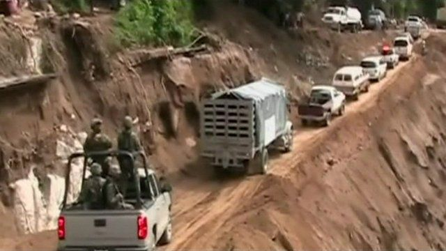 Military trucks delivering aid