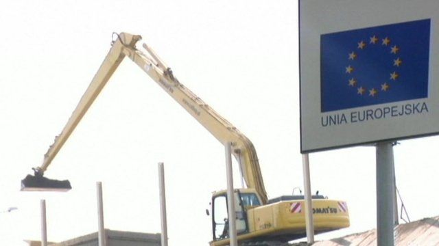 A digger working on a European building site