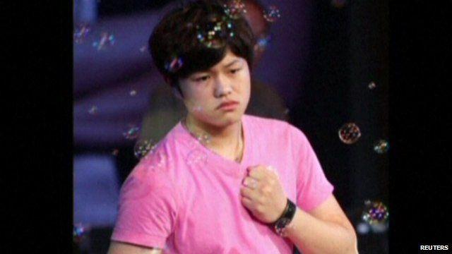 17 year old Li Tian-yi wearing a pink t-shirt