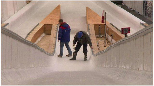 Men working on a ski jumping ramp
