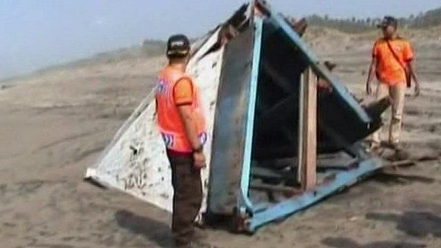 Part of boat on beach