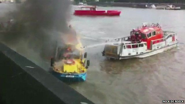 London Fire Brigade boat hosing the Duckboat