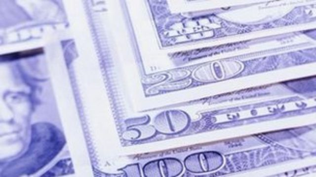Dollar sinks to 8-month low after US shutdown
