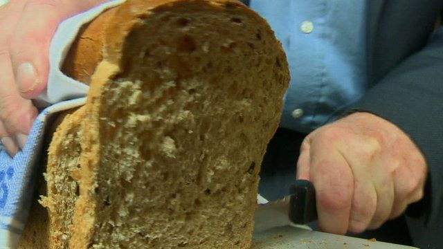 Loaf of bread being cut