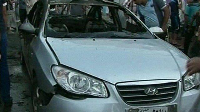 Damaged car in Balad