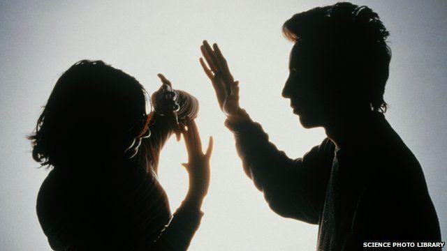 Man hitting a woman