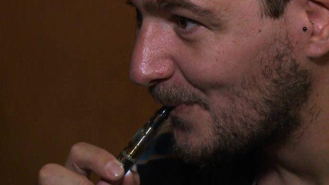 A man smoking an e-cigarette