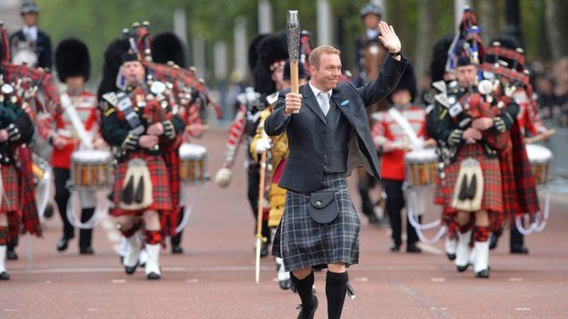 Sir Chris Hoy carrying the Commonwealth baton