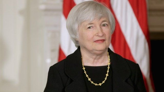 Janet Yellen listens as U.S. President Barack Obama speaks during a press conference to nominate her to head the Federal Reserve in the State Dining Room at the White House on October 9,