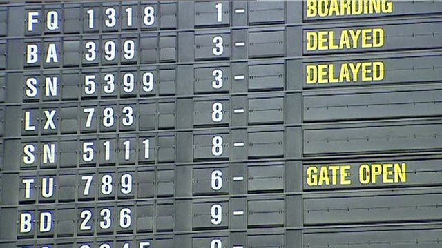 A flight departures board at an airport