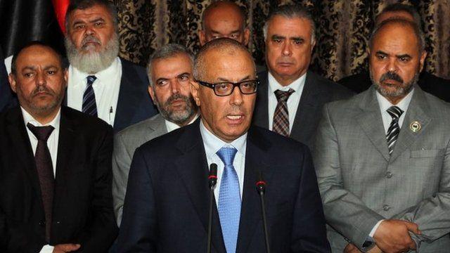 Libyan PM Ali Zeidan (centre) addresses the nation