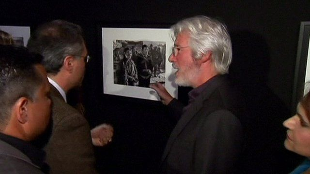 Actor and activist Richard Gere in front of one of his pictures at the exhibition