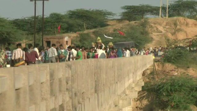 People gathered on the bridge