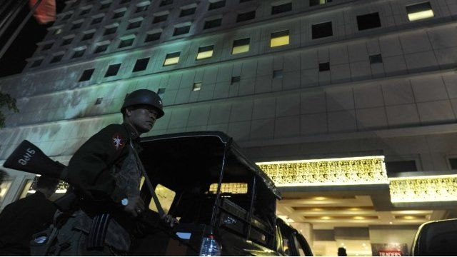 Armed solider outside blast hotel