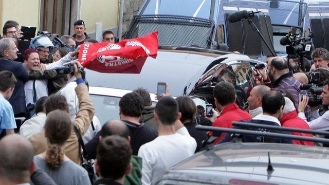Protesters surround the hearse carrying the coffin of Nazi war criminal Erich Priebke