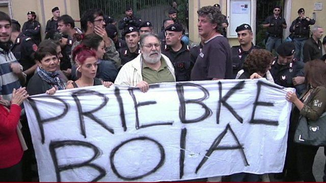 Protesters hold 'Priebka boia' banner