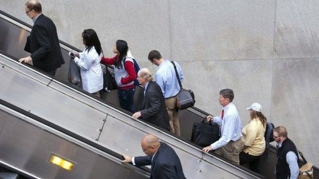 People exit a Metro subway station, by escalator, along Pennsylvania Ave., NW, in Washington, Thursday, Oct. 17, 2013