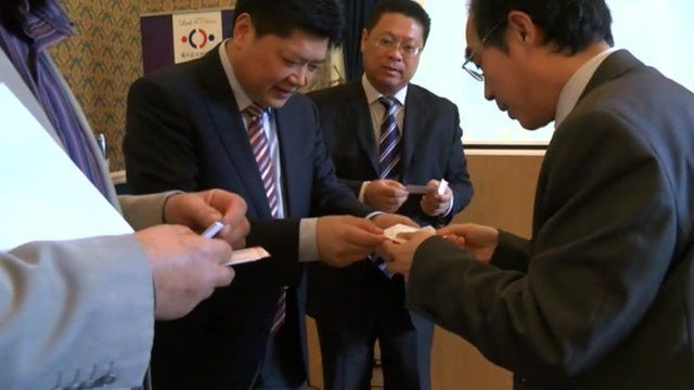 Chinese businessmen exchanging cards
