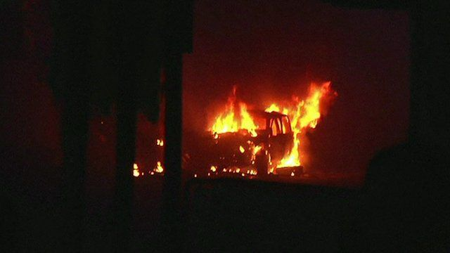 Burning car after Kabul compound attack