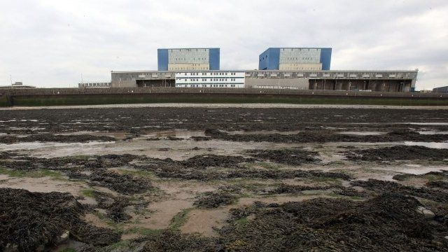 Mud surrounds the front of the old Hinkley Point