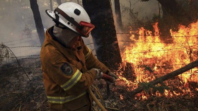 Firefighter battling a blaze in the Blue Mountains