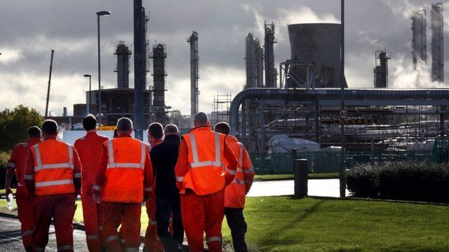 Workers walk through the Grangemouth complex
