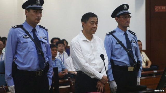 Bo Xilai in court next to security guards in August 2013