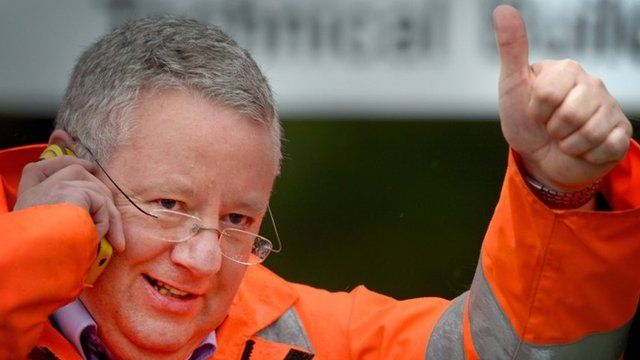 A worker gives a thumbs up after learning the Grangemouth plant will stay open